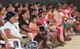 Mujeres atendiendo a charla sobre prevención de la violencia